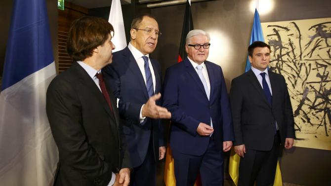 Political Director of the French Foreign Ministry de Riviere, Russian Foreign Minister Lavrov, German Foreign Minister Steinmeier and Ukrainian Foreign Minister Klimkin pose at the Munich Security Conference in Munich