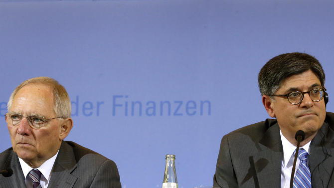 German Finance Minister Wolfgang Schaeuble, left, and his U.S. counterpart Jacob J. Lew, right, attend a press conference as part of a meeting at the finance ministry in Berlin, Germany, Tuesday, April 9, 2013. (AP Photo/Michael Sohn)