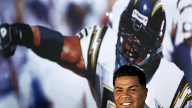 FILE - In this Aug. 14, 2006, file photo, former San Diego Chargers football player Junior Seau smiles during a news conference announcing his retirement from pro football in San Diego. Police have responded to a report of a shooting at the Seau's home in Oceanside, Calif., Wednesday morning, May 2, 2012. (AP Photo/Sandy Huffaker, File)