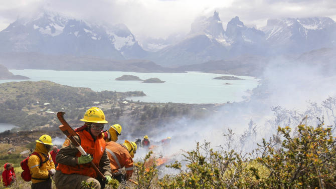 Firefighters work in an area of the Torres del Paine national park in Torres del Paine, Chile, Sunday Jan. 1, 2012. Firefighters are making progress against a major blaze that has burned at least 48 square miles (12,500 hectares) in one of Chile's most spectacular national parks. The Israeli tourist accused of setting the fire denied guilt. (AP Photo)