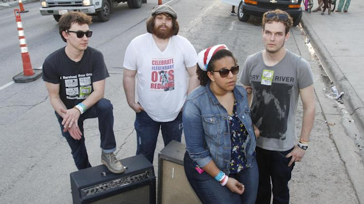FILE - In this March 15, 2012 file photo, the Alabama Shakes' from left, Heath Fogg, Zac Cockrell, Brittany Howard, and Steve Johnson pose for a photograph during the SXSW Music Festival in Austin, Texas. (AP Photo/Jack Plunkett)