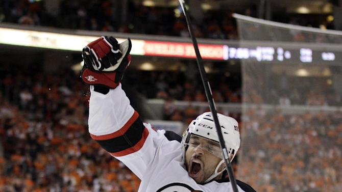 New Jersey Devils' Bryce Salvador celebrates after scoring a goal against Philadelphia Flyers goalie Ilya Bryzgalov, of Russia, in the first period of Game 5 of a second-round NHL hockey Stanley Cup playoff series, Tuesday, May 8, 2012, in Philadelphia. (AP Photo/Matt Slocum)
