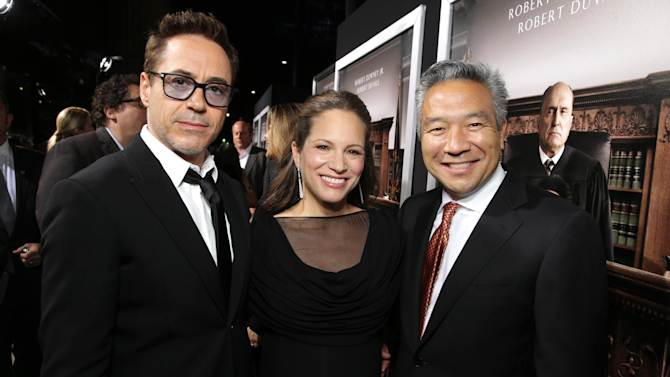 "Robert Downey Jr., Producer Susan Downey and Kevin Tsujihara, Chief Executive Officer of Warner Bros. seen at Warner Bros. Picture's Los Angeles Premiere of ""The Judge"" held at Samuel Goldwyn Theatre, AMPAS on Wed, Oct 1, 2014, in Los Angeles. (Photo by Eric Charbonneau/Invision for Warner Bros./AP Images)"