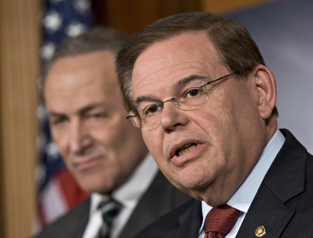 "FILE - In this Monday, Jan. 28, 2013 file photograph, Sen. Robert Menendez, D-N.J., right, and Sen. Charles Schumer, D-N.Y., left, announce with other senators that they have reached agreement on the principles of sweeping legislation to rewrite the nation's immigration laws, during a news conference at the Capitol in Washington. Menendez said Monday, Feb. 4, 2013, that allegations that he engaged with prostitutes in the Dominican Republic are false ""smears."" He said he has done nothing wrong and that allegations otherwise are ""totally unsubstantiated."" (AP Photo/J. Scott Applewhite, File)"