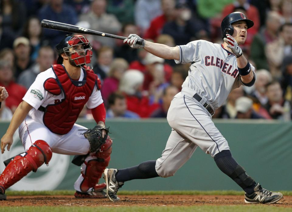 Cleveland Indians' Jack Hannahan, right, watches his two-run home run in front of Boston Red Sox catcher Kelly Shoppach in the second inning of a baseball game in Boston, Thursday, May 10, 2012. (AP Photo/Michael Dwyer