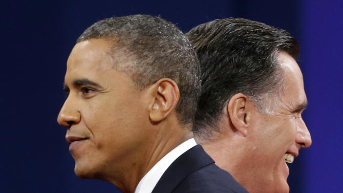 Republican presidential candidate, former Massachusetts Gov. Mitt Romney and President Barack Obama walk past each other on stage at the end of the last debate at Lynn University, Monday, Oct. 22, 2012, in Boca Raton, Fla. (AP Photo/Pablo Martinez Monsivais)