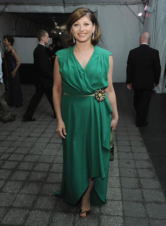 "Maria Bartiromo of CNBC's ""Closing Bell with Maria Bartiromo"" in an emerald wrap dress"