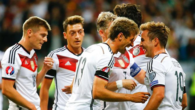 Germany's Mueller and Goetze celebrate a goal during their Euro 2016 qualification match against Poland in Frankfurt