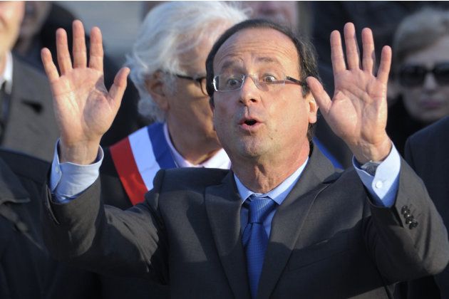 Francois Hollande, Socialist Party candidate for the 2012 French presidential election, waves after his speech at a ceremony in Paris to mark the mass killing of Armenians by Ottoman Turks 97 years ag