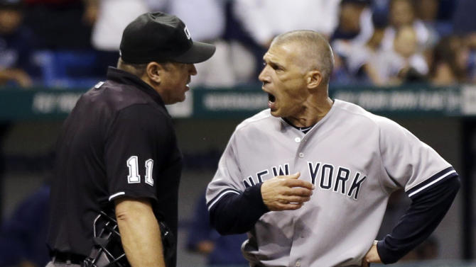 New York Yankees manager Joe Girardi, right, argues with home plate umpire Tony Randazzo after being ejected during the fourth inning of a baseball game against the Tampa Bay Rays, Tuesday, Sept. 4, 2012, in St. Petersburg, Fla. Girardi was arguing a strike call on Chris Dickerson. (AP Photo/Chris O'Meara)