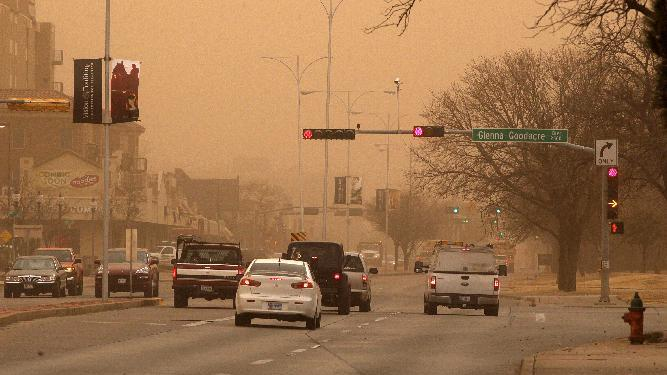 Cars navigate along University Avenue during a dust storm in Lubbock, Texas, Wednesday, Dec. 19, 2012. (AP Photo/Lubbock Avalanche-Journal, Zach Long) ALL LOCAL TV OUT