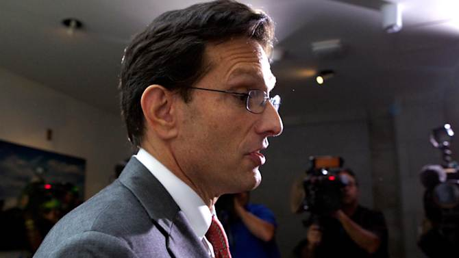 House Majority Leader Eric Cantor of Va., walks out of a Republican caucus at the U.S. Capitol in Washington, Saturday, Sept. 28, 2013. Lawmakers from both parties urged one another in a rare weekend session to give ground in their fight over preventing a federal shutdown, with the midnight Monday deadline fast approaching. (AP Photo/Molly Riley)
