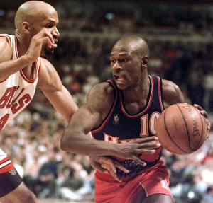 FILE- In this May 8, 1997, file photo, Atlanta Hawks' Mookie Blaylock (10) drives against the Chicago Bulls' Ron Harper during the fourth quarter of an NBA basketball playoff game in Chicago. Police say the former Hawks guard is on life support after a car crash in suburban Atlanta on Friday, May 31, 2013. (AP Photo/Michael S. Green, File)