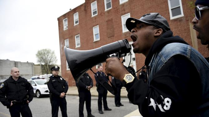 Demonstrators gather in front of Baltimore Police Department Western District station to protests against the death in police custody of Freddie Gray in Baltimore