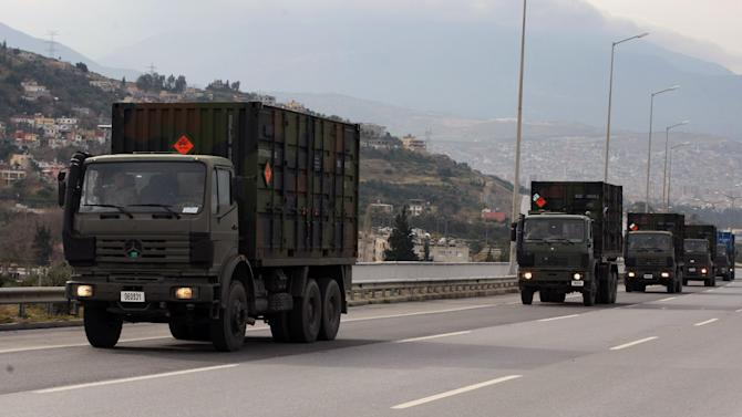 Dutch military truck carrying NATO's Patriot Missile Defense System to protect Turkey in case neighboring Syria launches an attack leave the the Mediterranean port city of Iskenderun, Turkey, Tuesday, Jan. 22, 2013. The Dutch Patriot Systems and troops were heading for Adana to prepare to operate a defensive missile system close to the border with Syria.(AP Photo/Burhan Ozbilici)