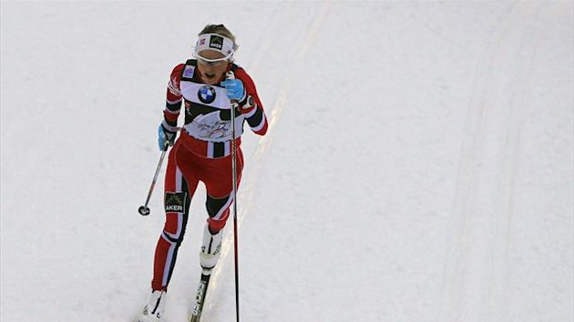 Therese Johaug of Norway competes on her way to win the ladies' FIS World Cup cross-country skiing 5km classic individual race on the Lago di Tesero track in Val di Fiemme January 4, 2014 (Reuters)