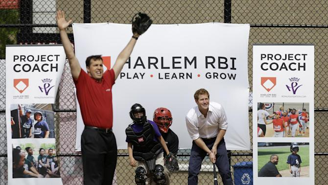 New York Yankees first baseman Mark Teixeira reacts, left, after pitching to Britain's Prince Harry, who hit the ball during a visit to launch a partnership between Harlem RBI  and the Royal Foundation of the Duke and Duchess of Cambridge and Prince Harry in New York, Tuesday, May 14, 2013.  (AP Photo/Kathy Willens)