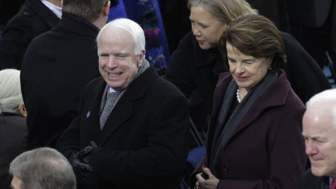 Sen. John McCain, R-Az., and Sen. Dianne Feinstein, D-Calif., arrive for the ceremonial of President Barack Obama swearing-in at the U.S. Capitol during the 57th Presidential Inauguration in Washington, Monday, Jan. 21, 2013. (AP Photo/Paul Sancya)