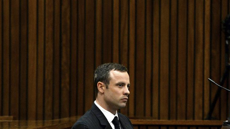 Olympic and Paralympic track star Oscar Pistorius listens to a witness testifying at the North Gauteng High Court in Pretoria