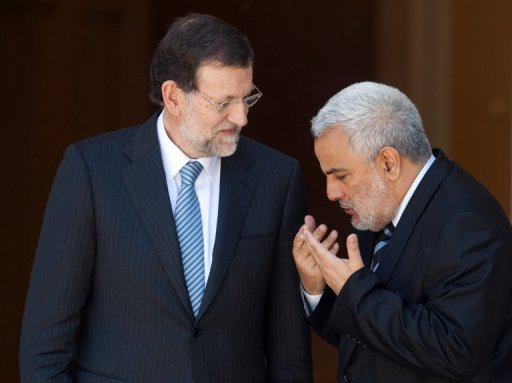 <p>This file photo shows Spain's Prime Minister Mariano Rajoy (L) welcoming Moroccan Prime Minister Abdelilah Benkirane at the Moncloa Palace in Madrid, in May. The economic crises rocking Spain and Morocco may favour stronger ties between the neighbouring kingdoms ahead of a top-level Spanish delegation's visit to Rabat, despite their historic differences.</p>