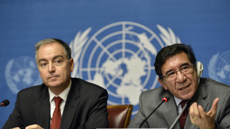 Radhouane Nouicer, the U.N.'s regional humanitarian coordinator for Syria, right, speaks during a joint news conference with Panos Moumtzis, the U.N. refugee agency's coordinator for the region, left, at the headquarters of the United Nations in Geneva, Switzerland, Friday, Nov. 9, 2012. Nouicer said after an international meeting on Syrian humanitarian aid that the country is seeing unrelenting increases in violence. (AP Photo/Keystone, Martial Trezzini)