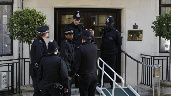 Police Officers stand guard outside the King Edward VII hospital in central London Tuesday, Dec. 4, 2012, where Kate, the Duchess of Cambridge has been admitted with a severe form of morning sickness.   Prince William and his wife Kate are expecting their first child, it was announced Monday.  The Duchess of Cambridge is suffering from a severe form of morning sickness in the early stages of her pregnancy, and is widely expected to stay in hospital for several days. (AP Photo/Sang Tan)