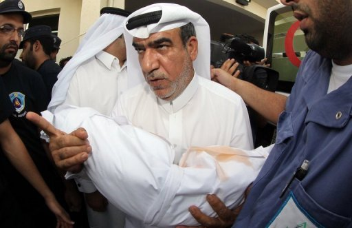 <p>A Qatari man carries the body of his child, who died in a blaze that whipped through a shopping mall in Doha on Monday. Firefighters in Qatar told Wednesday how they tried to rescue 13 children trapped by a blaze in a mall nursery but by the time they reached the toddlers most were dead, huddled in the arms of two fellow firemen who perished during the rescue attempt.</p>