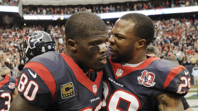Houston Texans' Andre Johnson (80) and Glover Quin (29) celebrate their 43-37 win over the Jacksonville Jaguars in overtime at an NFL football game on Sunday, Nov. 18, 2012, in Houston. (AP Photo/Dave Einsel)