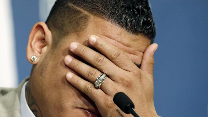 Seattle Mariners' Felix Hernandez covers his face as he becomes emotional during a news conference, Wednesday, Feb. 13, 2013, in Seattle. Hernandez signed a seven-year contract with the Mariners that makes him the highest-paid pitcher in baseball. The new deal will be worth $175 million. (AP Photo/Elaine Thompson)