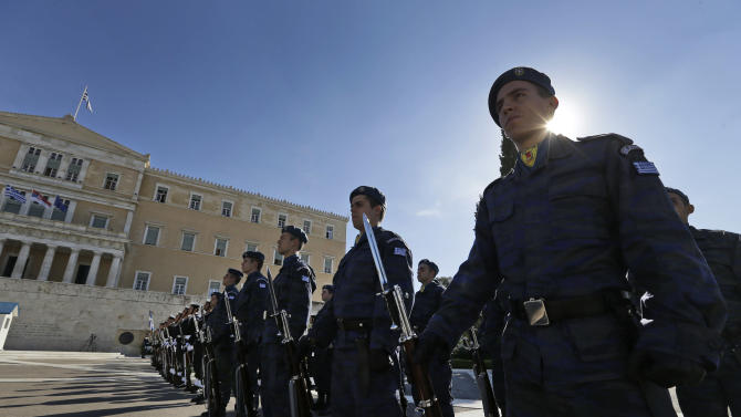 Greek Air Force soldiers form an honor guard in front of the Tomb of the Unknown Soldier as they wait for visiting Serbian President Tomislav Nikolic to arrive and lay a wreath, at the parliament in central Athens, Friday, Nov. 9, 2012. Cash-strapped Greece will issue short term debt on Tuesday in the hope of raising enough money to repay a key bond days later. Greece is not expected to get its next batch of international rescue loans by Nov. 16, when it has to roll over 5 billion euros in three-month treasury bills. (AP Photo/Lefteris Pitarakis)