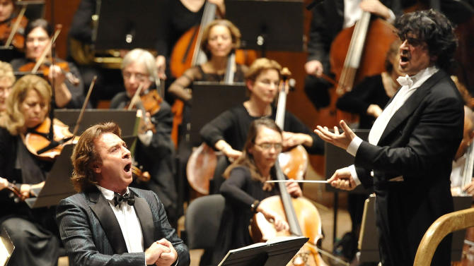 "In this Jan. 6, 2013 provided by the Opera Orchestra of New York,  Roberto Alagna sings the title role of Giordano's 1896 opera, ""Andrea Chenier,""  in a concert performance with the Opera Orchestra of New York in New York as Umberto Giordano conducts. (AP Photo/ Opera Orchestra of New York, Stephanie Berger)"
