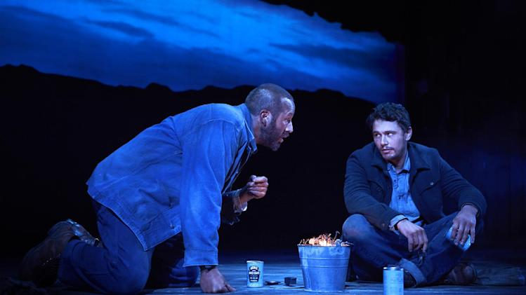 "This image released by Polk & Co. shows James Franco, right, and Chris O'Dowd in a scene from ""Of Mice and Men,"" in New York. Franco's play ""Of Mice and Men"" has left Broadway with a roar _ a box office record. The show, co-starring Chris O'Dowd and Leighton Meester, said Monday, July 28, 2014, it earned $1,038,106 for the week ending Sunday, setting a new 8-performance weekly record gross at the Longacre Theatre and marking the first time the theater ever housed a show that crossed the $1 million mark. (AP Photo/Polk & Co., Richard Phibbs)"