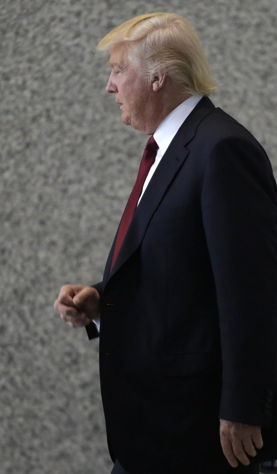 Donald Trump arrives at federal court Tuesday, May 14, 2013, in Chicago. Trump is set to testify at a civil trial where he's accused of enticing investors to buy condos at his Chicago skyscraper with promises of profit-sharing, then quietly reneging on them. (AP Photo/M. Spencer Green)