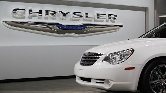 A Chrysler Sebring sits in front of the Chrysler logo at the New York International Auto Show in New York