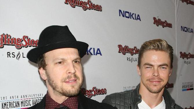 Gavin DeGraw, left, and Derek Hough arrive at the Rolling Stone American Music Awards After Party, on Sunday, Nov. 18, 2012 in Los Angeles. (Photo by Casey Rodgers/Invision for Nokia/AP Images) **Please include any additional event details in the second sentence of the caption.