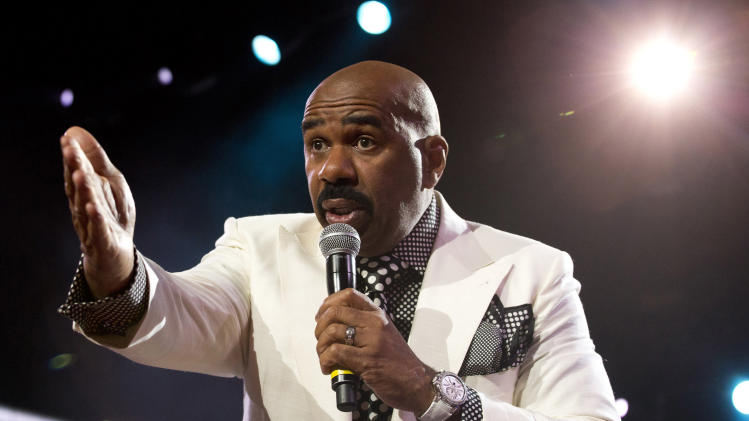 FILE - This May 12, 2012 file photo shows comedian Steve Harvey performing at Gospelfest in Newark, N.J. Harvey will host the NAACP Image Awards airing live on Feb. 1, 2013 on NBC. (AP Photo/Charles Sykes, file)