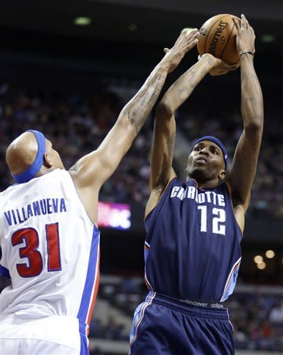 Walker leads Bobcats past Pistons in OT