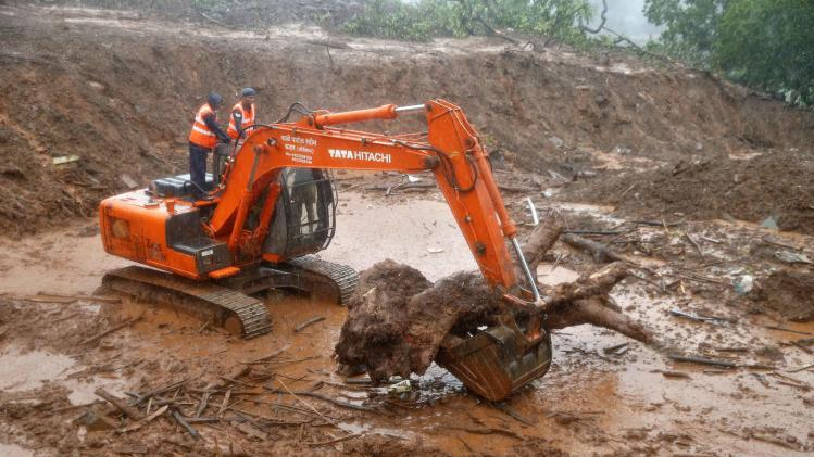 NDRF personnel clear the debris from the site of a landslide at Malin village