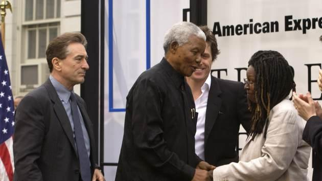 Robert DeNiro watches as Whoopi Goldberg shakes hands with Nelson Mandela at the 2002 Tribeca Film Festival Opening Night Ceremony, May 8, 2002 -- Getty Images