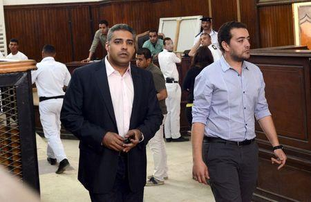 Al-Jazeera television journalists Mohamed Fahmy (L) and Baher Mohamed are seen at a court in Cairo