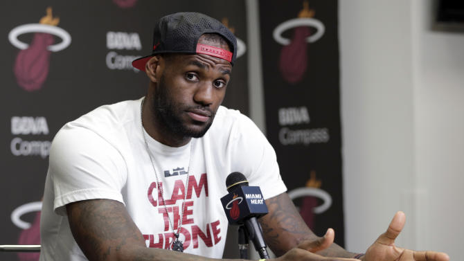 FILE - In this June 17, 2014 file photo, Miami Heat's LeBron James gestures as he answers a question during a news conference in Miami. LeBron James held meetings for more than three hours in a Las Vegas hotel Tuesday, July 8, 2014 leaving without giving any indication of what team he'll play for next season. (AP Photo/Alan Diaz, File)