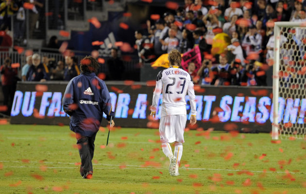 Los Angeles Galaxy midfielder David Beckham, right, and assistant coach Kobe Jones walk off the field after FC Dallas defeated them in their MLS Western Conference Final playoff match, Sunday, Nov. 14