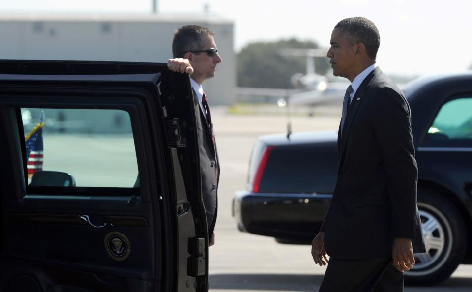 "President Barack Obama arrives at Southwest Florida International Airport in Ft. Myers, Fla., Friday, July 20, 2012. Obama is cutting short a Florida campaign swing following the deadly Colorado movie theater shooting. He called the shooting ""horrific"". (AP Photo/Susan Walsh)"