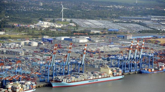 Shipping terminals and containers are pictured in the harbour of Bremerhaven