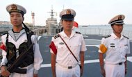 Chinese sailors stand onboard a frigate berthed in Shanghai on September 22, 2011. China's navy has taken delivery of a new type of stealth frigate that is expected to bolster the country's maritime defences amid territorial disputes, state media reported Tuesday