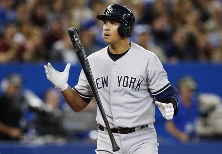 Yankees Rodriguez reacts to striking out against the Blue Jays during their MLB baseball game in Toronto