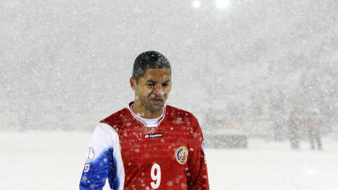 Costa Rica forward Alvaro Saborio (9) hangs his head as he leaves the snow covered field following a 1-0 loss to the United States during the second half of a World Cup qualifier soccer match in Commerce City, Colo., Friday, March 22, 2013. The United States beat Costa Rica 1-0. (AP Photo/Jack Dempsey)