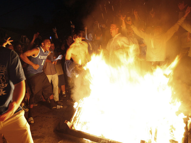 Kentucky fans dance around a fire on State Street as they celebrate Kentucky&#39;s 69-61 win over Louisville in an NCAA Final Four semifinal college basketball tournament game, Saturday, March 31, 2012, in Lexington, Ky. (AP Photo/The Courier-Journal, Amy Wallot) NO SALES; MAGS OUT; NO ARCHIVE; MANDATORY CREDIT