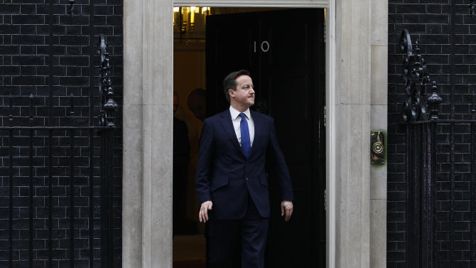Britain's Prime Minister David Cameron, walks out of 10 Downing Street to greet his Italian counterpart Mario Monti outside 10 Downing Street in London Wednesday, Jan. 18, 2012. (AP Photo/Alastair Grant)