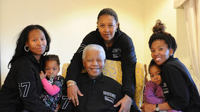In this hand out photograph supplied by Peter Morey Photographic for the Mandela family, showing former South Africa president Nelson Mandela, center, with family members left to right Zaziwe Manaway, Ziphokazi Manaway, Zamaswazi Dlamini and Zamak Obiri at Mandela's hometown in Qunu, South Africa, Sunday July 17, 2011. Mandela celebrates his 93rd birthday Monday July 18, 2011. Center back is Mandela';s daughter Princess Zenani Dlamini. (AP Photo/Peter Morey Photographic-HO) NO SALES, EDITORIAL USE ONLY